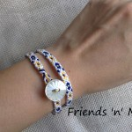 Friendship Bracelet - Double wrap in blue and yellow flower with a pearl like plastic button